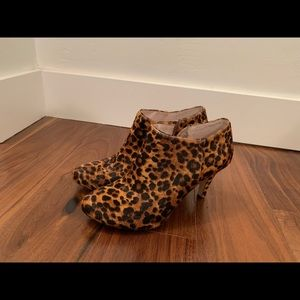 Cheetah faux fur boots by Vince Camuto